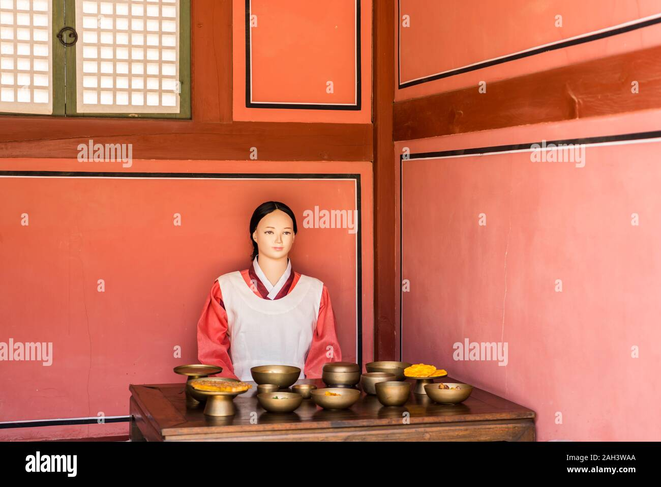 Dressed mannequin of a maid in an imperial palace serving food at  Hwaseong Haenggung Palace, the ornate residential palace built for King Jeongjo whe Stock Photo