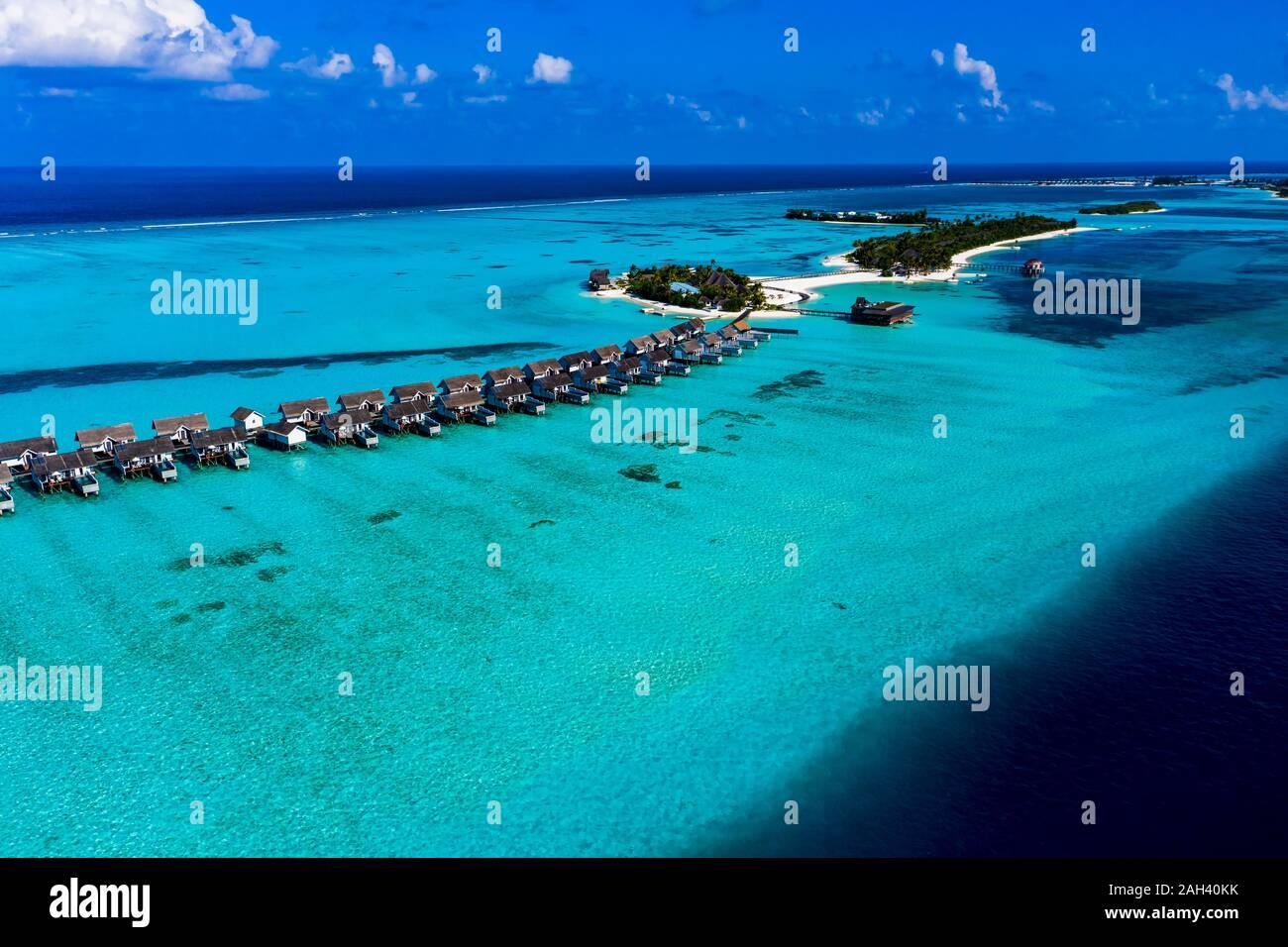 Maldives, South Male Atoll, Kaafu Atoll, Aerial view of Bungalows on sea Stock Photo