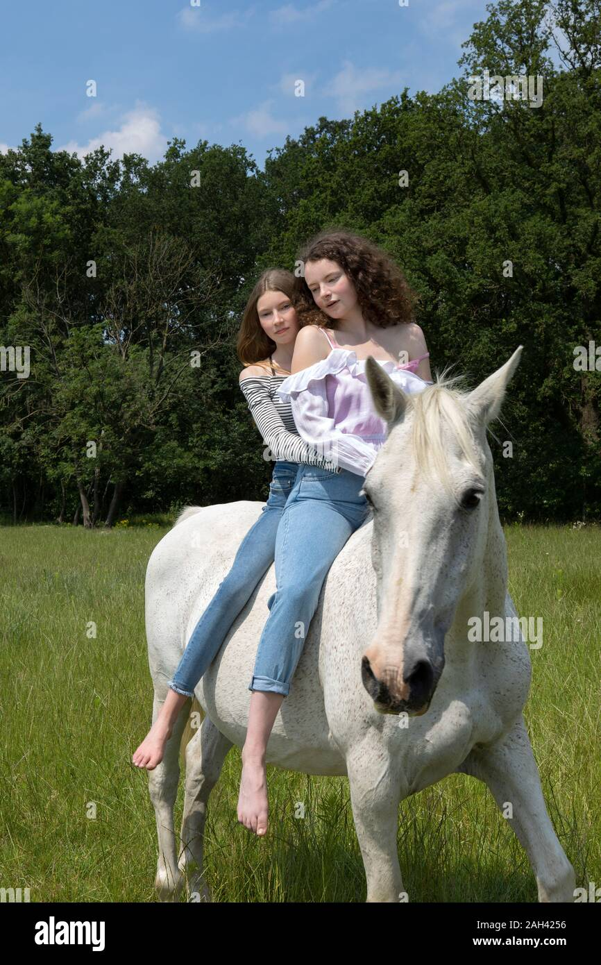 Portrait Of Two Best Friends Riding Together On A Horse Stock Photo Alamy