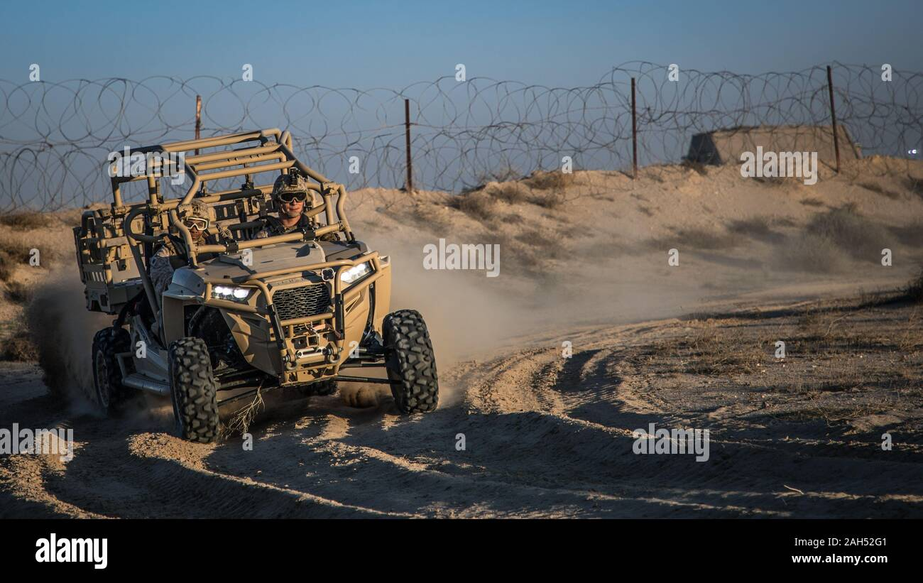 U.S. Marines with 2nd Battalion, 7th Marines, assigned to the Special Purpose Marine Air-Ground Task Force – Crisis Response – Central Command (SPMAGTF-CR-CC) 19.2, drive a Utility Task Vehicle (UTV) during a tactical vehicle driving course in Kuwait, Dec. 21, 2019. The SPMAGTF-CR-CC is a quick reaction force, prepared to deploy a variety of capabilities across the region. (U.S. Marine Corps photo by Sgt. Branden J. Bourque) Stock Photo
