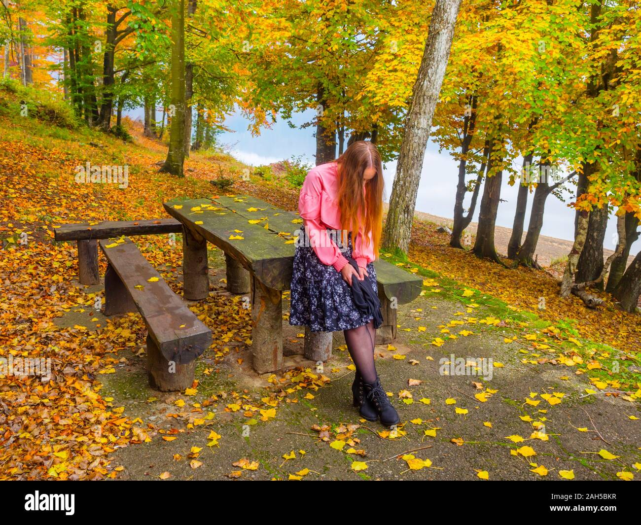 Country-girl countrygirl in countryside near lake river sad waiting for somebody looking down hiding identity face Stock Photo