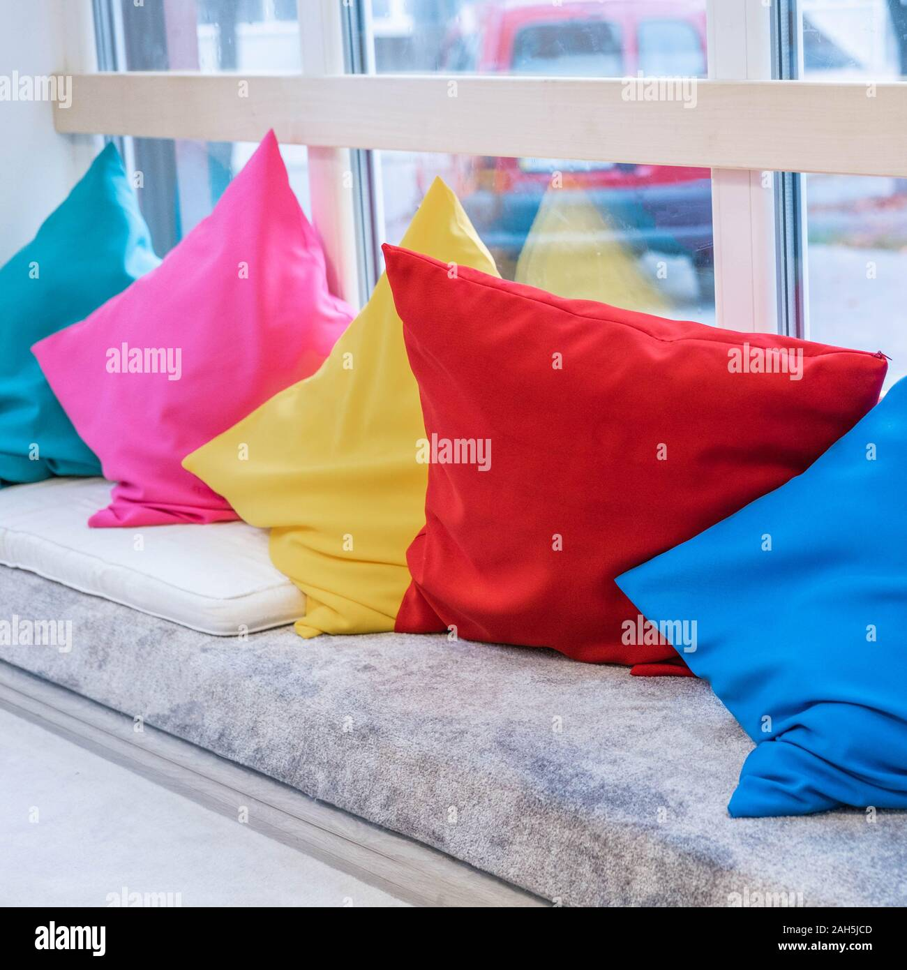 Cozy Design Of The Sofa With Pillows Of Different Colors Rainbow Colors Stock Photo Alamy