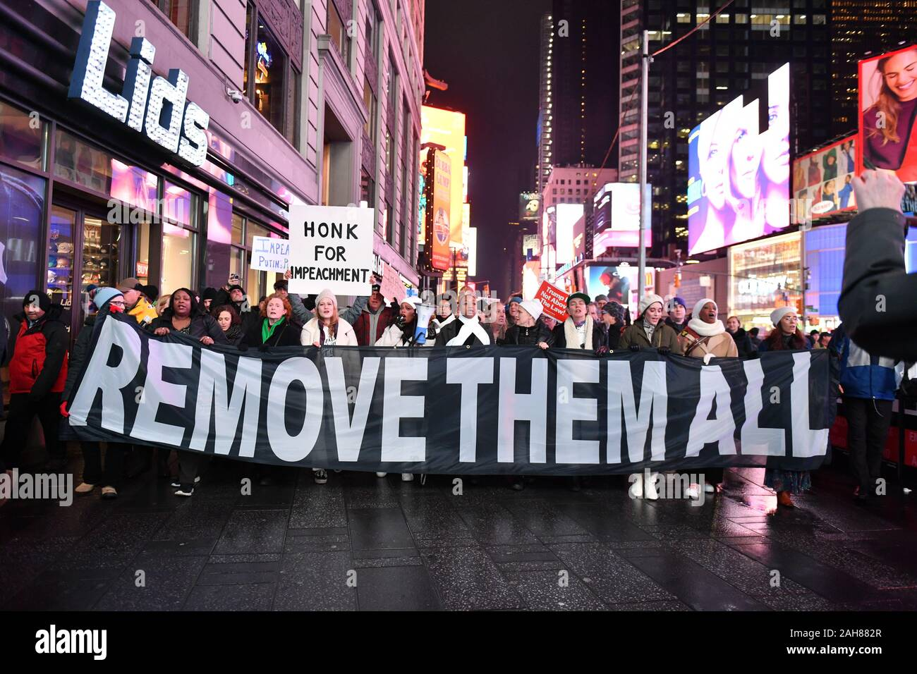 The New York City Coalition to Impeach and Remove join national demonstrations to demand an end to Donald Trump's presidency on December 17, 2019 in T Stock Photo