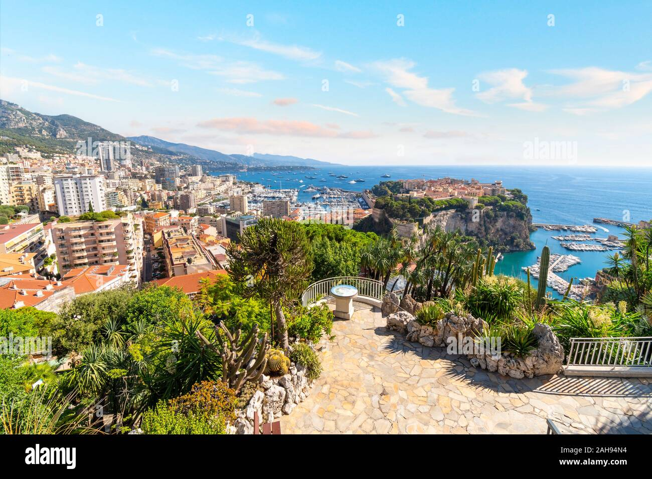 View of the Mediterranean Sea, and the marina, port, cities of Monte Carlo and Fontvieille, and rock of Monte Carlo, Monaco, from the Exotic Gardens. Stock Photo