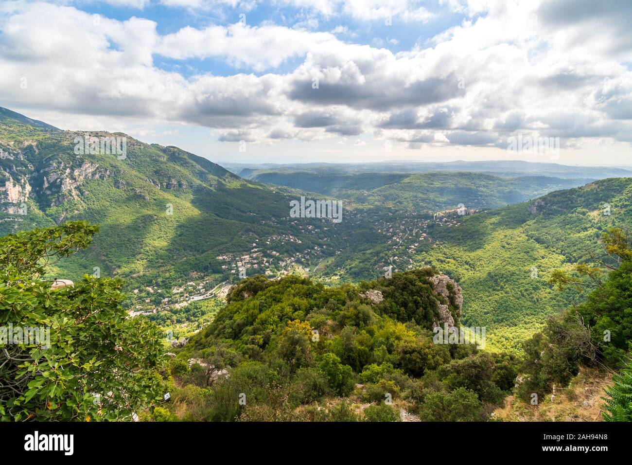 View of the Alpes-Maritimes mountains and valleys in the Provence region from the medieval hilltop village of Gourdon, France Stock Photo