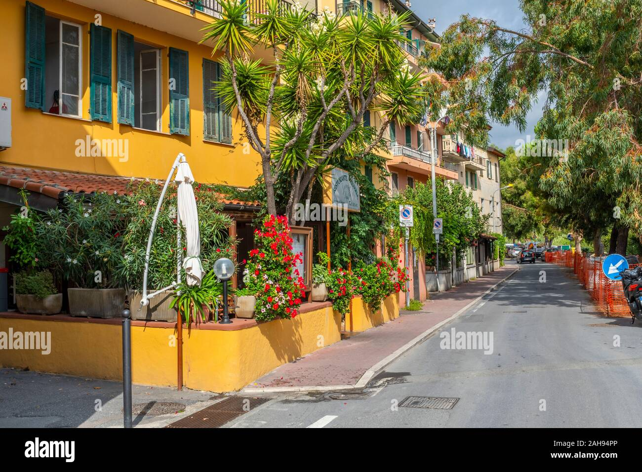 A colorful restaurant with a patio on the outskirts of the Ligurian city of Ventimiglia, Italy, on the Italian Riviera Stock Photo