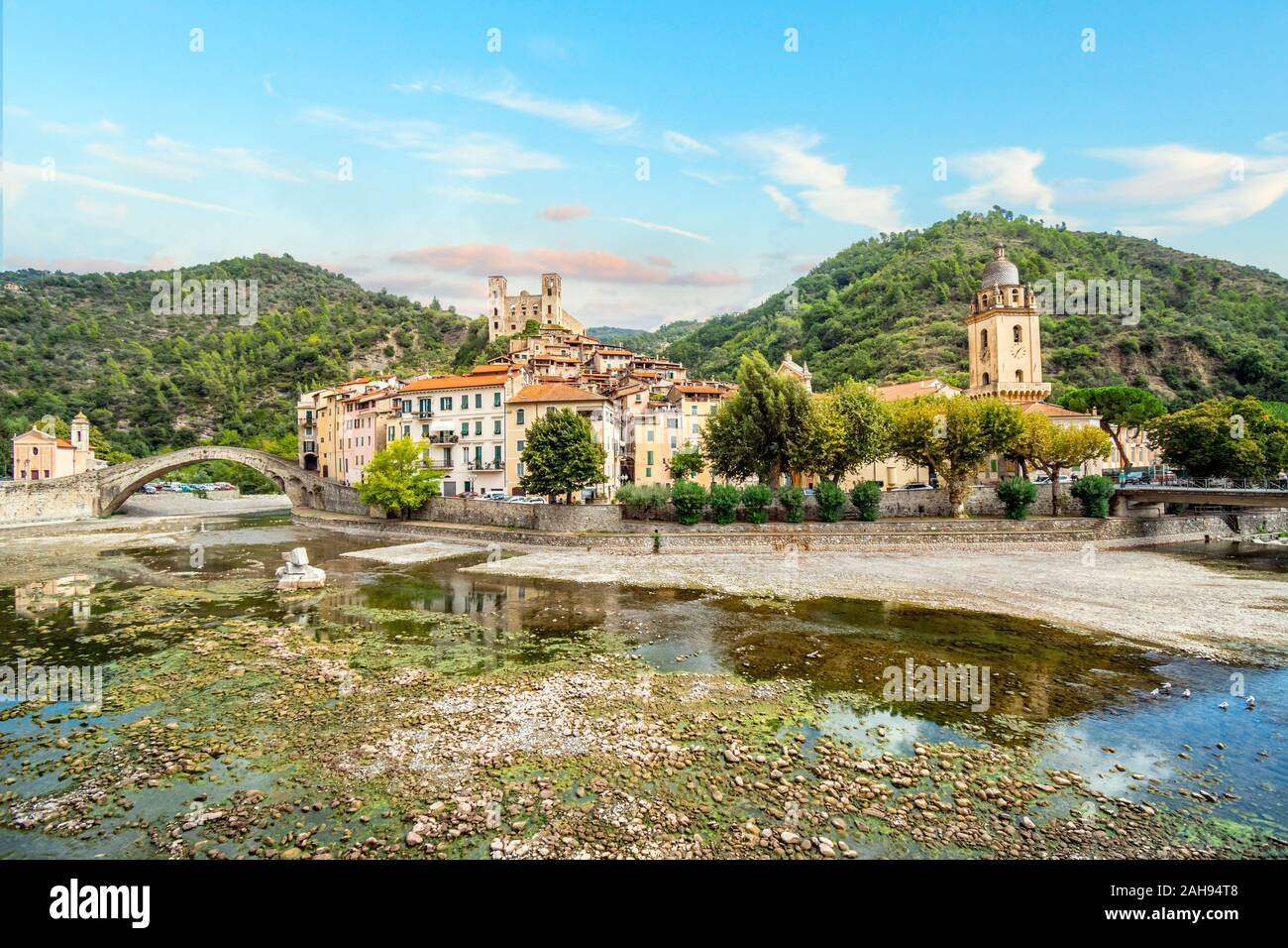 The medieval village of Dolceacqua Italy, showing the San Filippo Church, hilltop Castello castle, arched Monet bridge, and ancient cathedral. Stock Photo