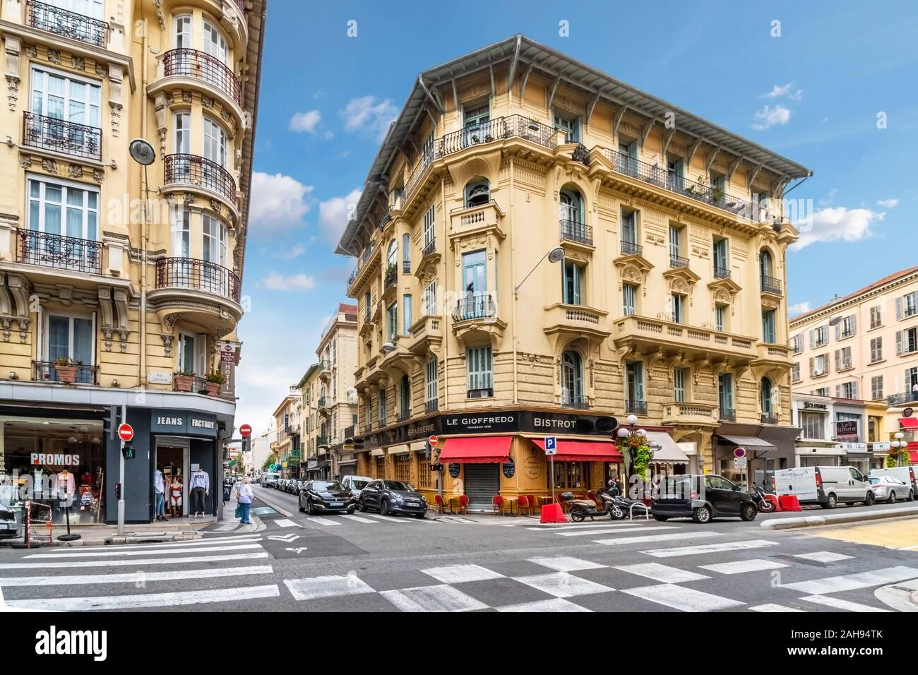 A French Bistro sits on a typical corner near the touristic city center of Nice, France, on the French Riviera. Stock Photo