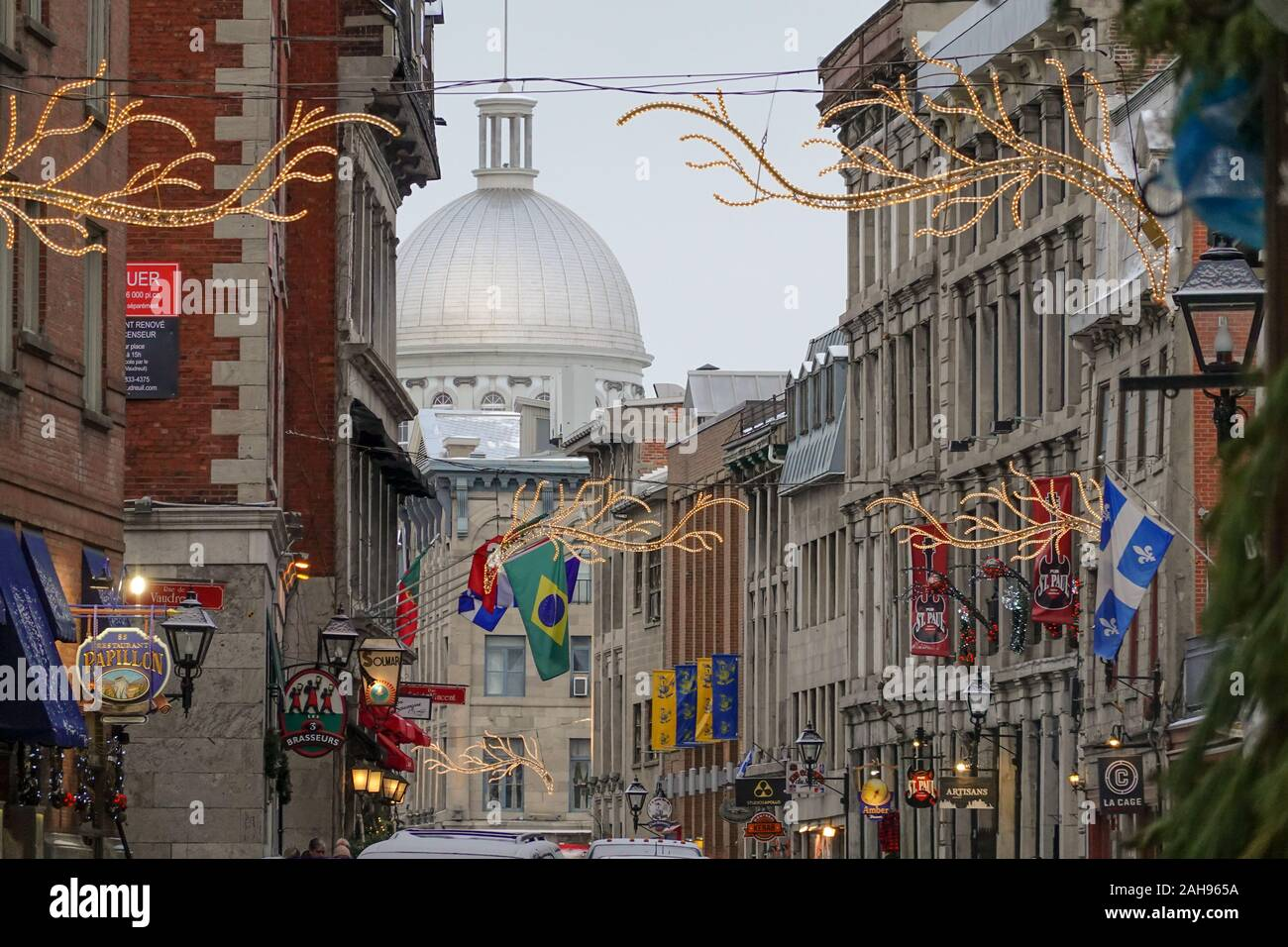 street view in old port Montreal showing multi nations flags of ...