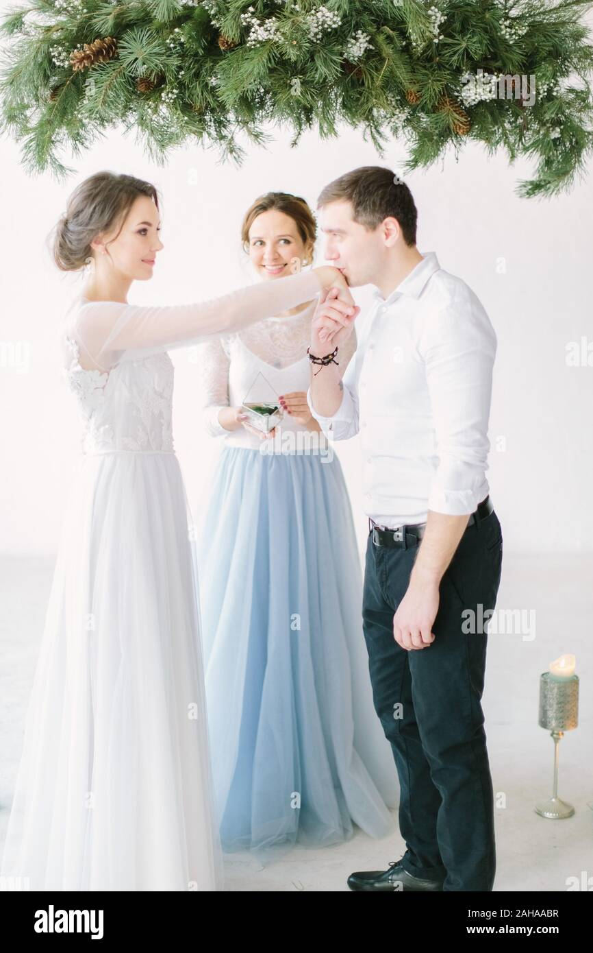 Beautiful Smiling Master Of Wedding Ceremony Holding Glass Box