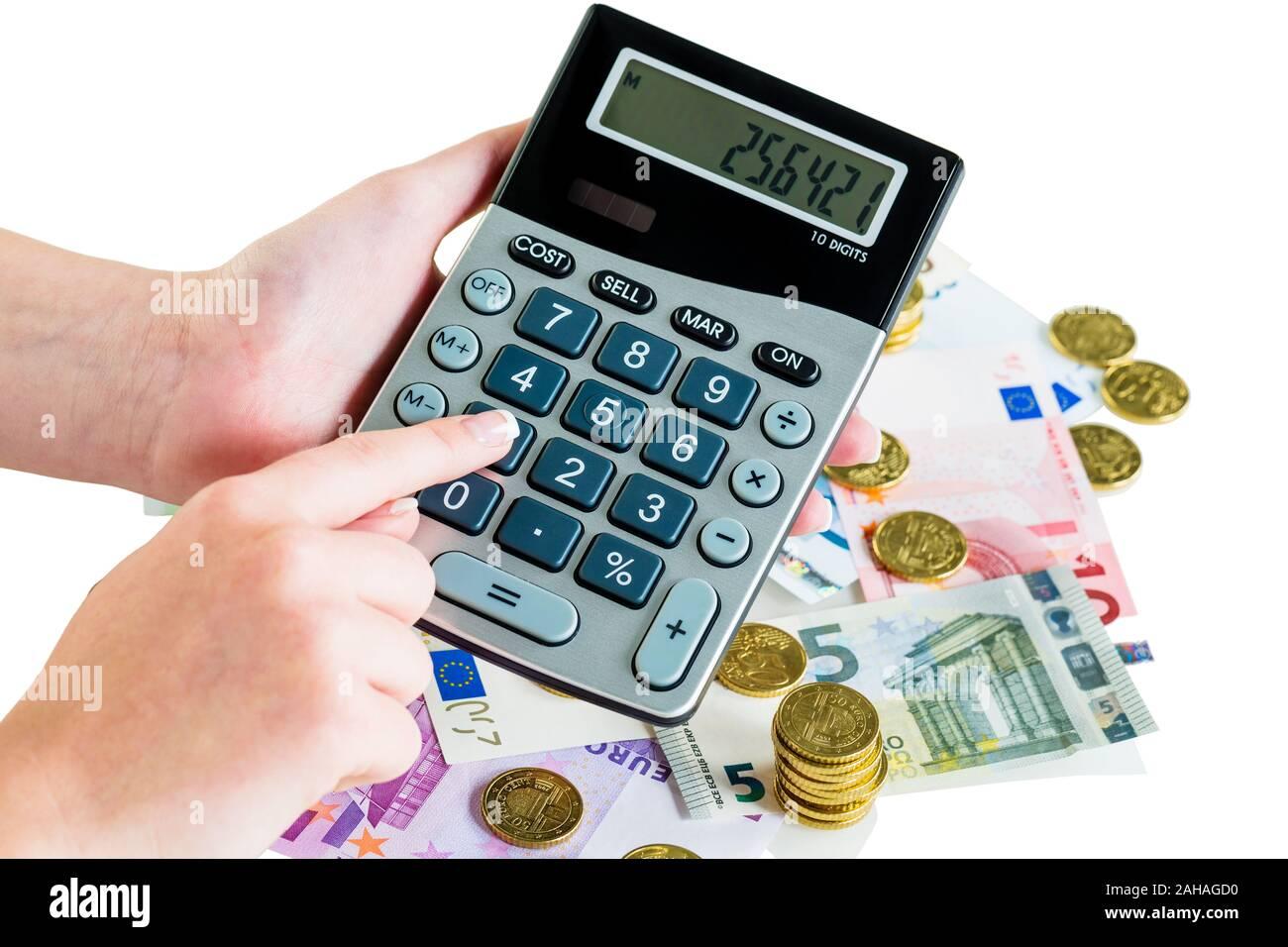 Viele verschiedene Euro Geldscheine und Münzen, Symbolfoto für Reichtum und Geldanlage. Taschenrechner, Ausgabenkontrolle, Stock Photo