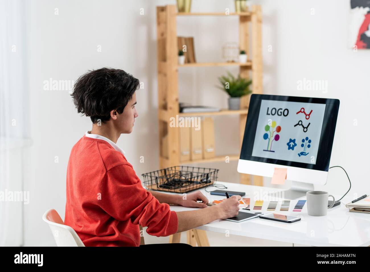 Contemporary Web Designer With Graphics Tablet Drawing New Logo By Workplace Stock Photo Alamy