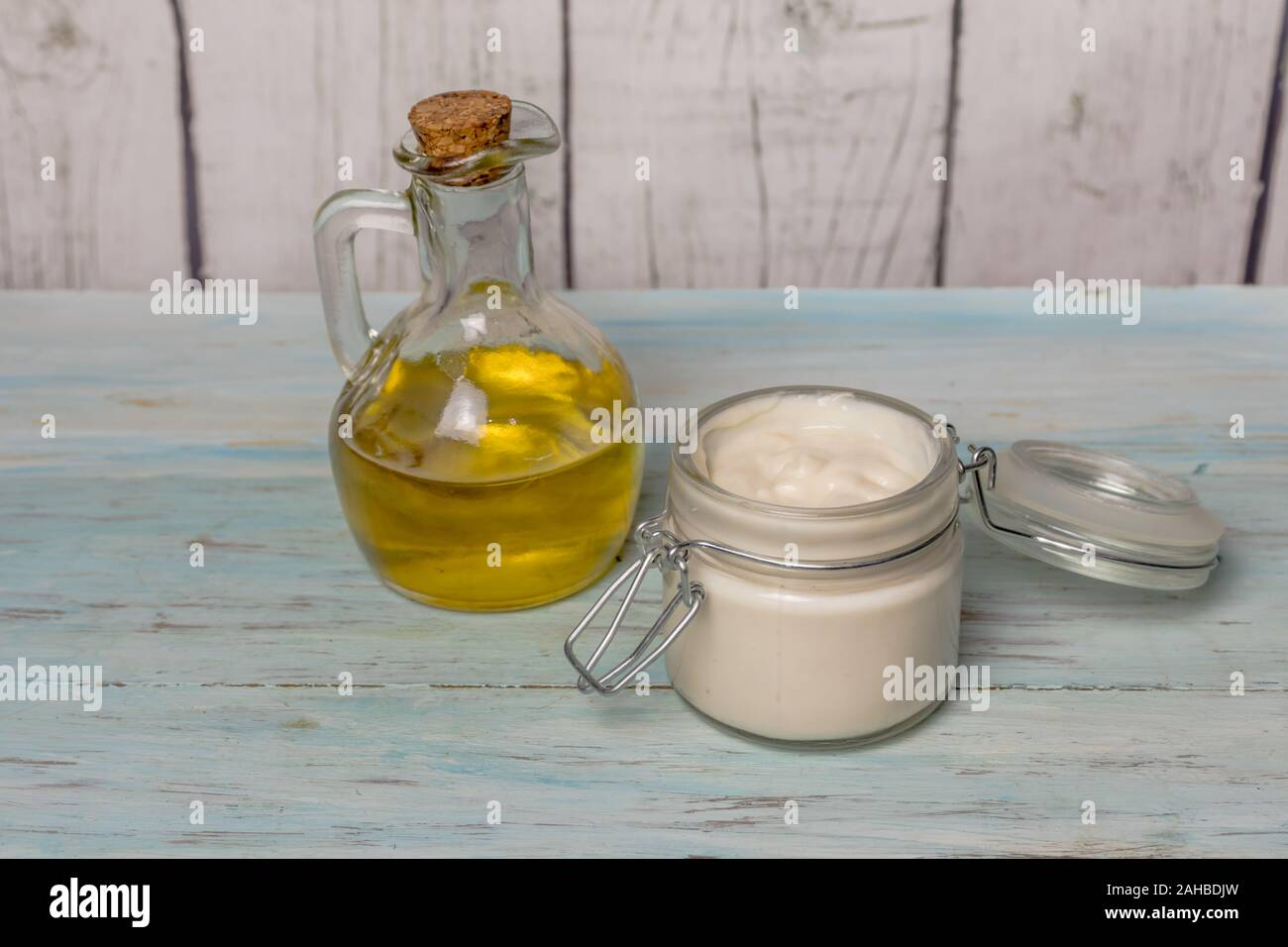 Homemade olive oil face cream, in glass jar, with oil filled with olive oil. Medicine and alternative health Stock Photo