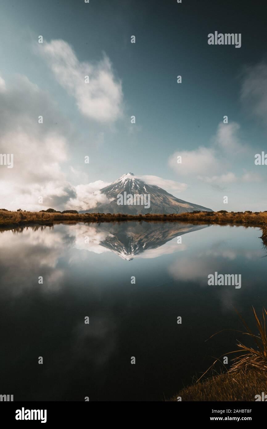 Mirror Lake with Mount Taranaki Volcano New Zealand Stock Photo