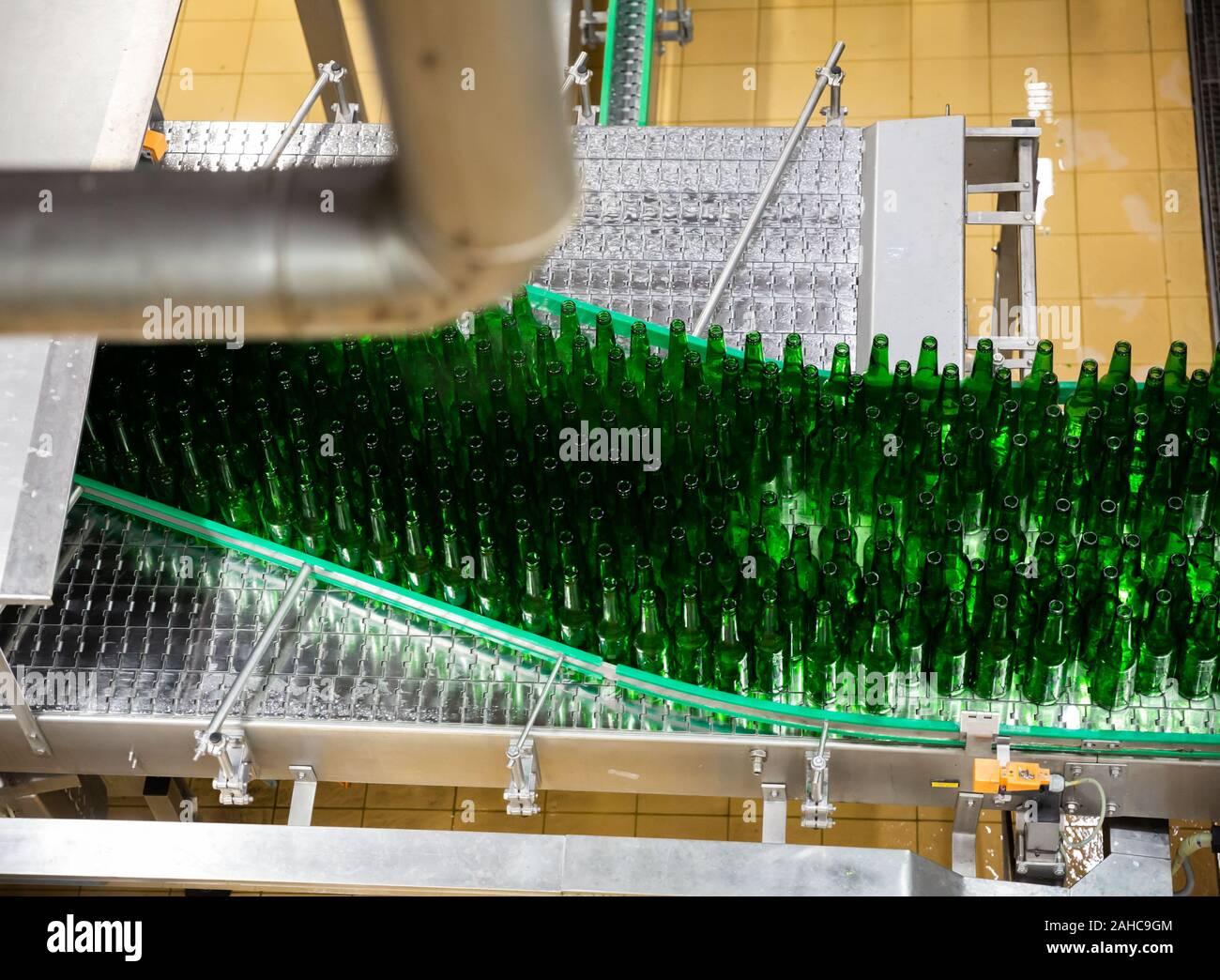 View of empty bottles on conveyor of bottling line at modern brewery Stock Photo