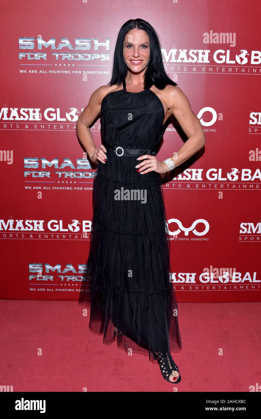 HOLLYWOOD, CA - DECEMBER  19:  Traci Lynn Cowan arrives for the SMASH GLOBAL IX Fight Night  on December 19, 2019 2019 in Hollywood California. (Photo Stock Photo