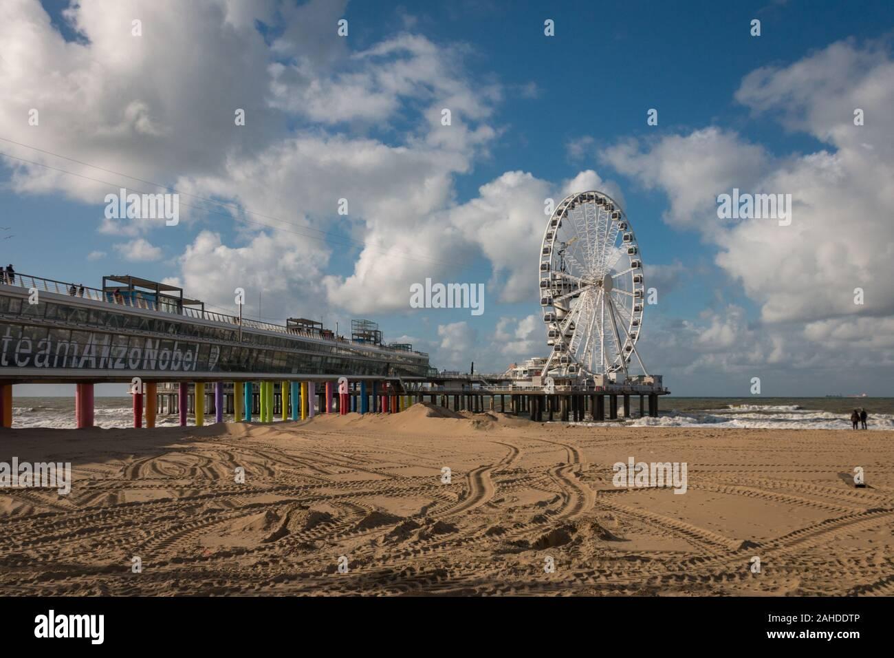Scheveningen, the Netherlands - October 3, 2017: Pier of Scheveningen with ferris wheel and bungee tower seen from the right side Stock Photo