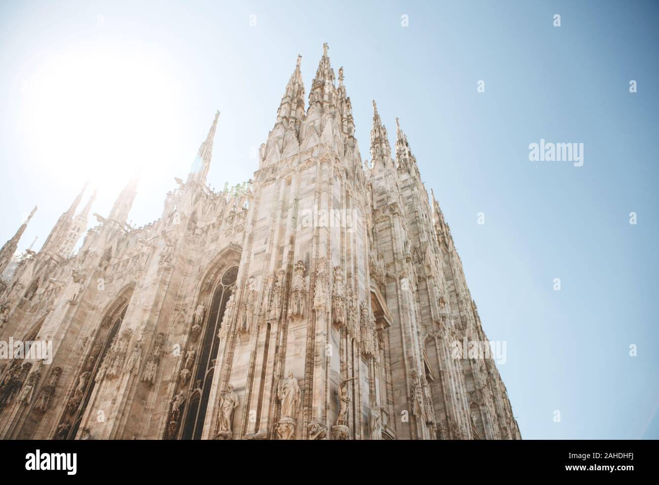 Beautiful view of the ancient Duomo Cathedral in Milan in Italy. It is one of the most popular tourist attractions in Italy. Stock Photo