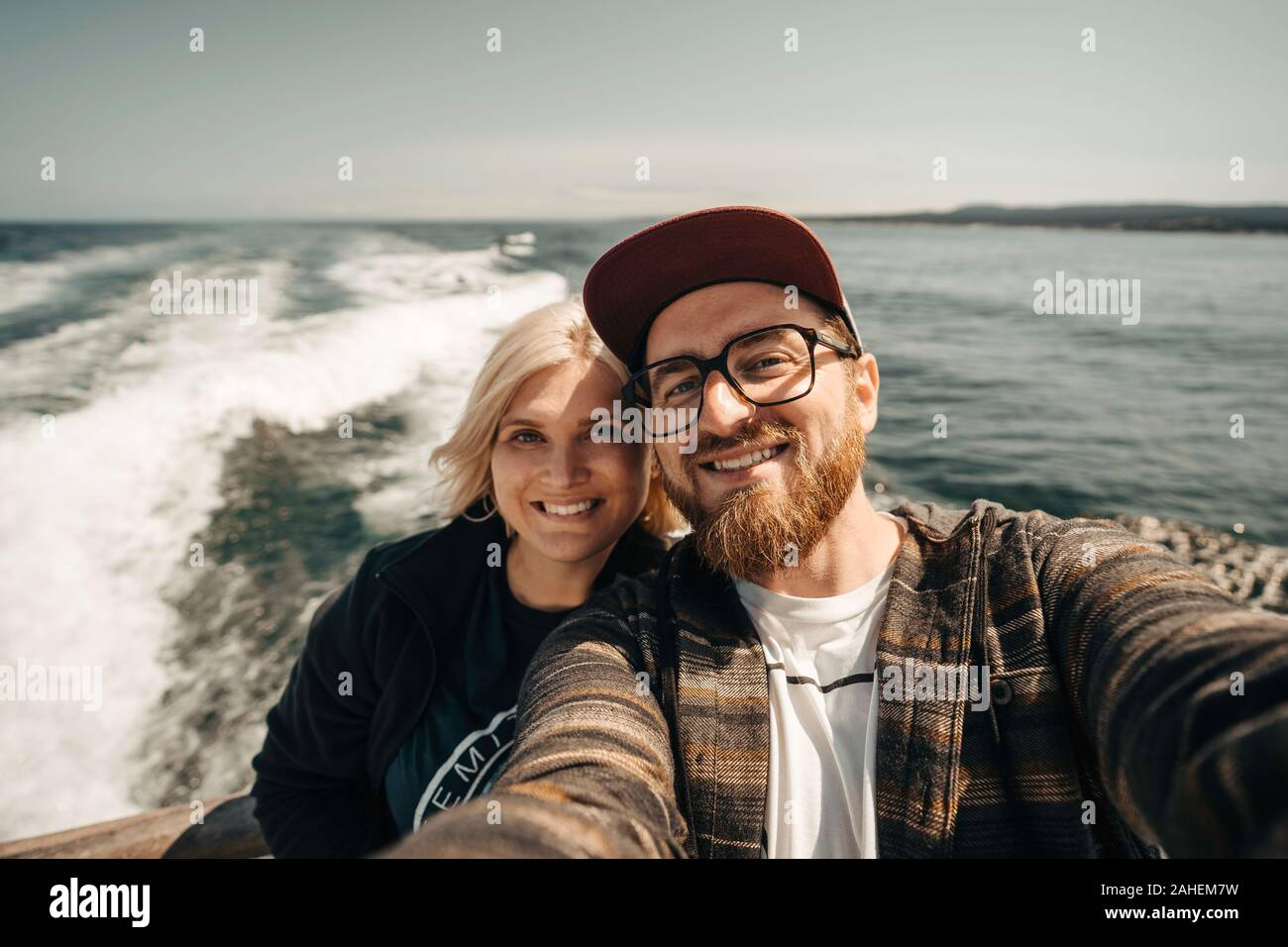 Happy couple takes a selfie on boat tour Stock Photo