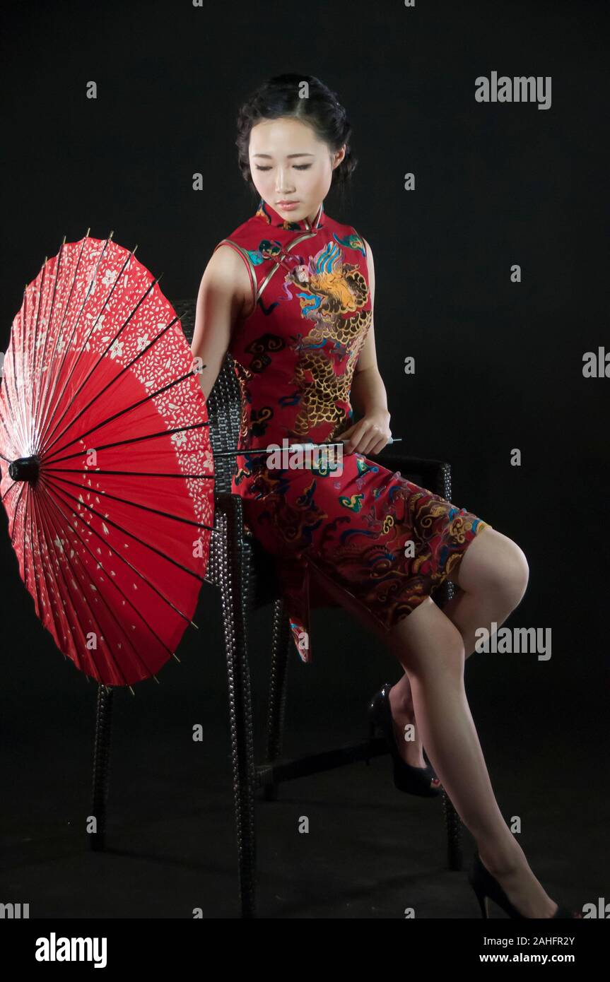 Asian female, in various poses wearing traditional Chinese qipao or cheongsam a traditional fashion Stock Photo