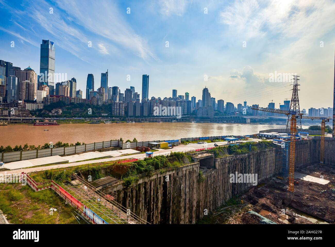 High-rise buildings and construction sites along the Yangtze River in Chongqing Stock Photo