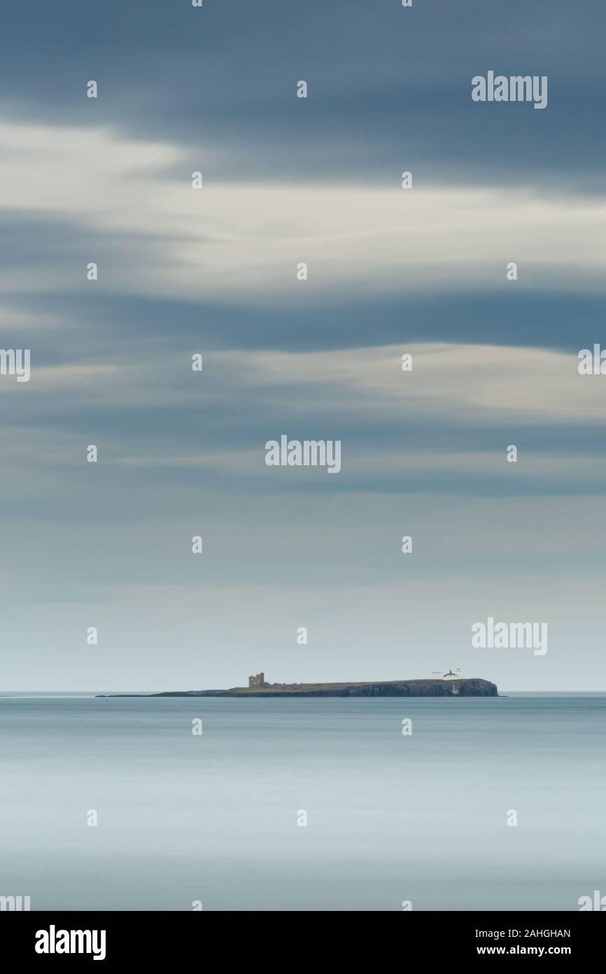 Farne Island from Bamburgh beach, Northumberland, a long exposure. Stock Photo