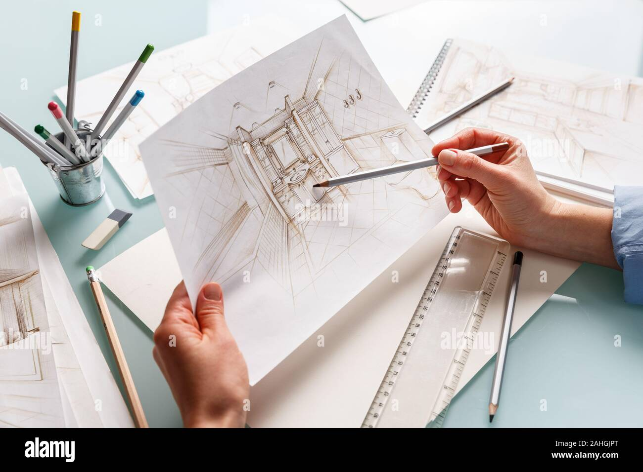Interior Designer Holding Hand Drawing Pencil Sketch Of A Bathroom Interior Design Projects Concept Stock Photo Alamy