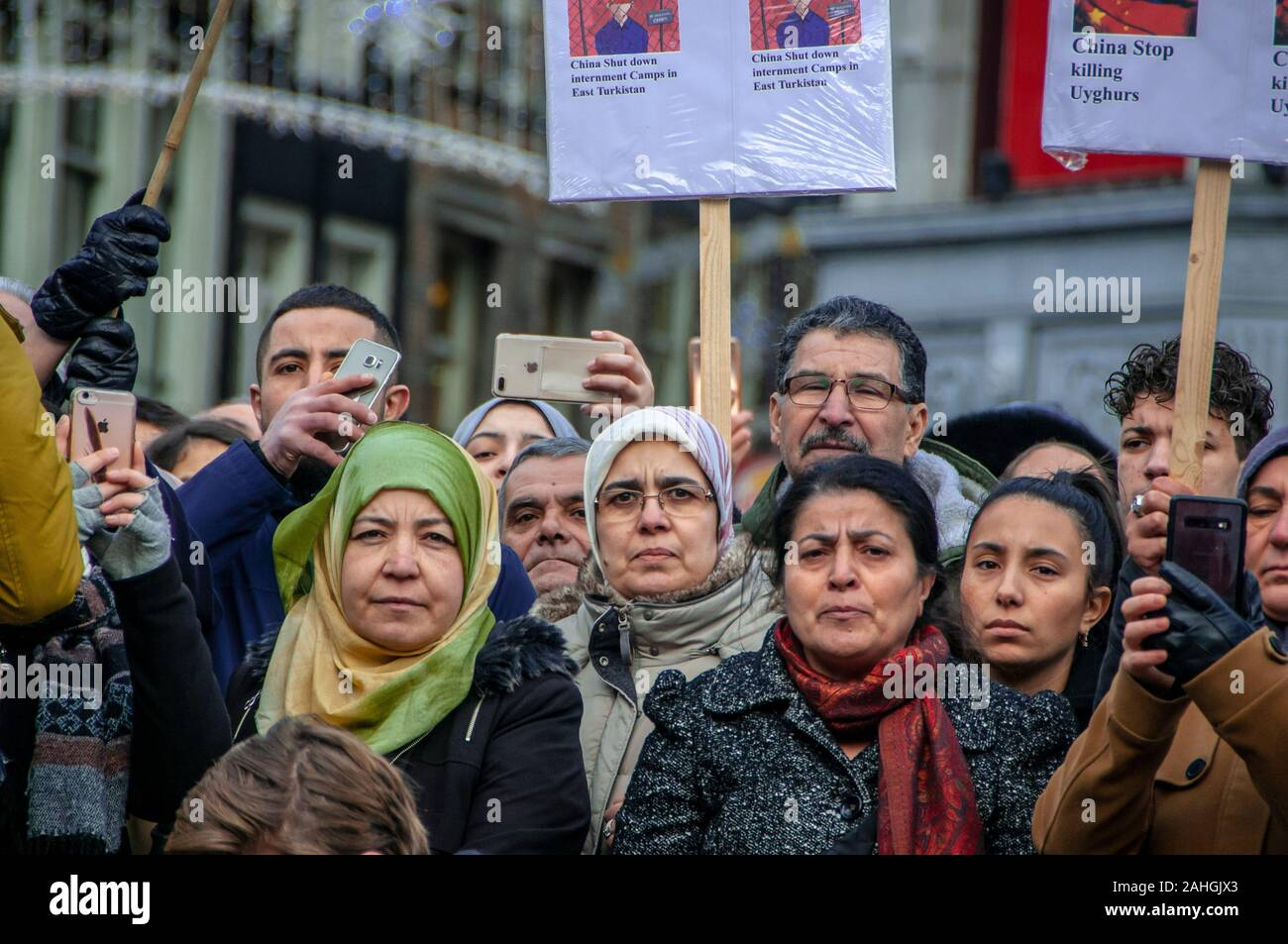 The Dam, Amsterdam, The Netherlands. Sunday 29th December, 2019. An Anti-Chinese demonstration this afternoon, as a large group of protesters gathered to denounce the systematic policy of China, to erase the ethnic and cultural identity of Uighurs and other Muslim minorities in Xinjiang. The Chinese government has detained more than a million muslins in detention camps in, a so-called reeducation program. The Uyghurs and other Turkic Muslims are culturally and ethnically distant from China's majority ethic Han Chinese population. © Charles M Vella/Alamy Live News Stock Photo