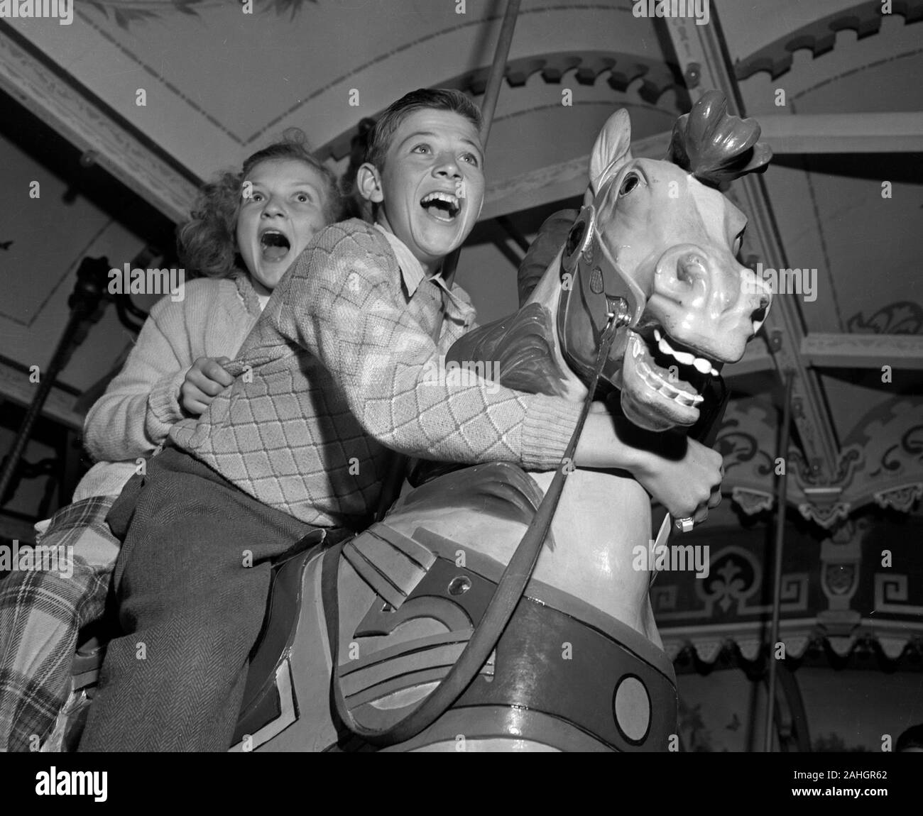 Children on a merry-go-round 1946 Stock Photo