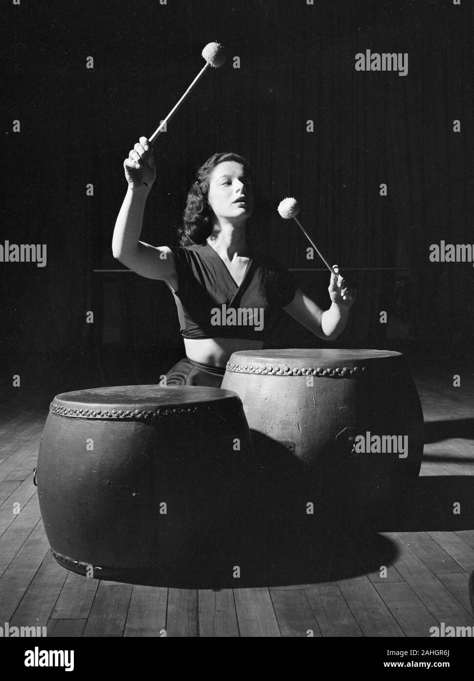 Woman banging drums 1946 Stock Photo
