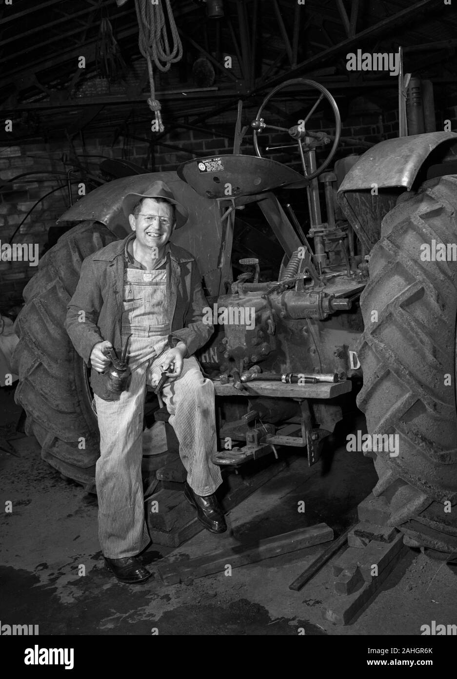 Farmer working on his tractor 1946 Stock Photo