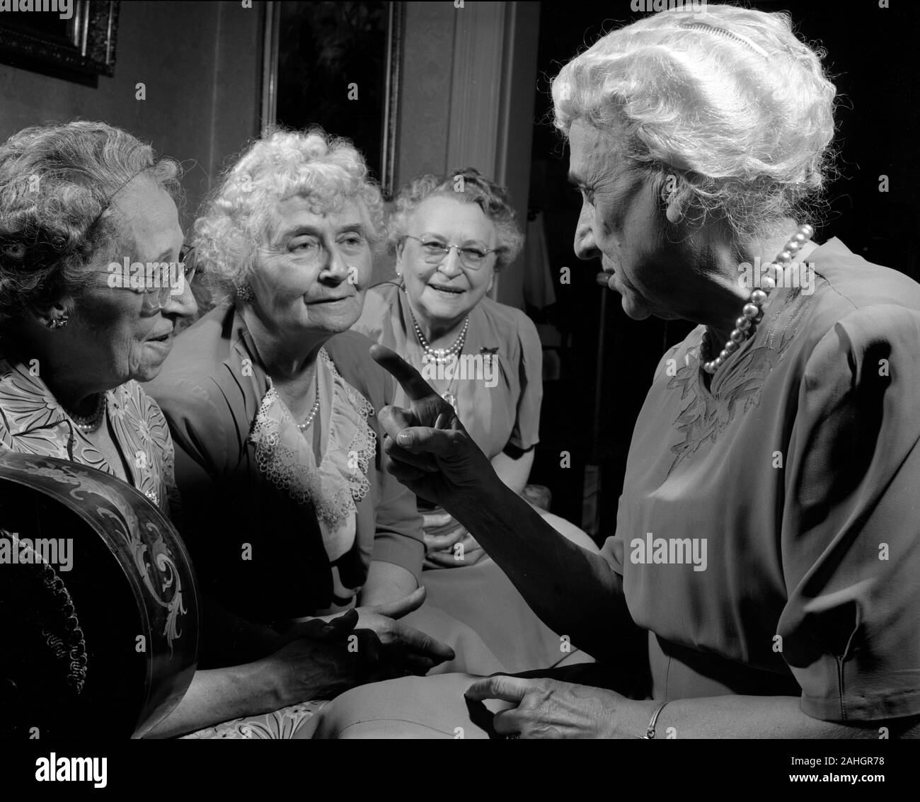 Elderly women gossiping 1946 Stock Photo