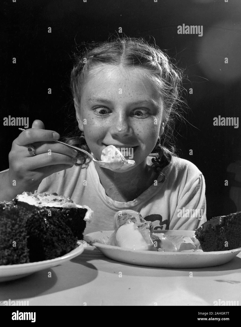 Girl eating ice cream 1946 Stock Photo