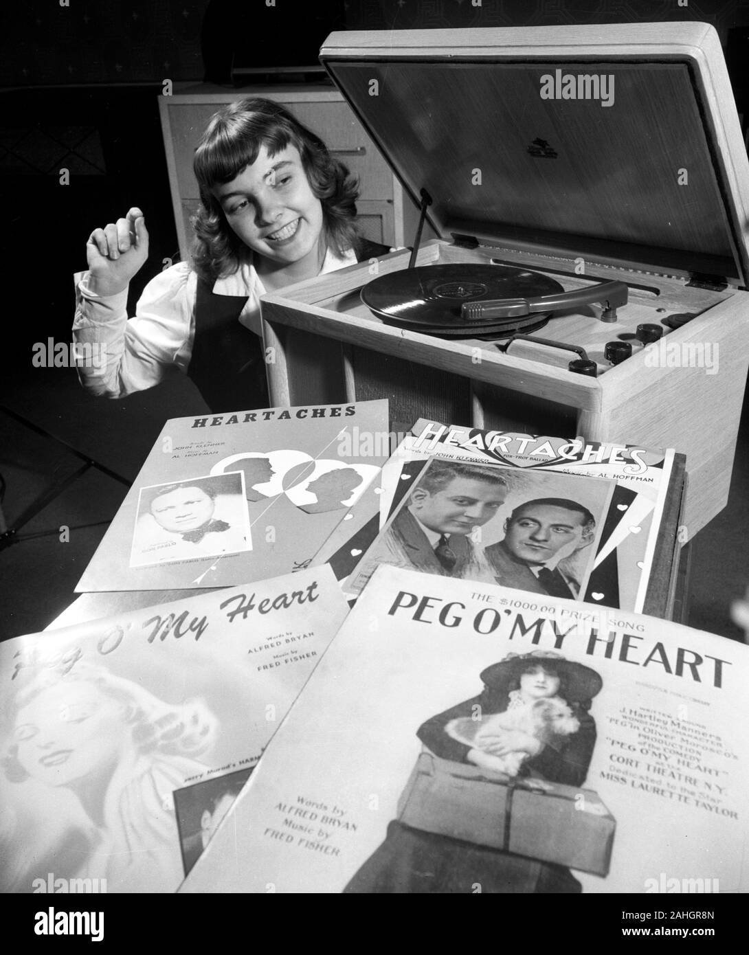 Teenager listening to music on a phonograph 1946 Stock Photo