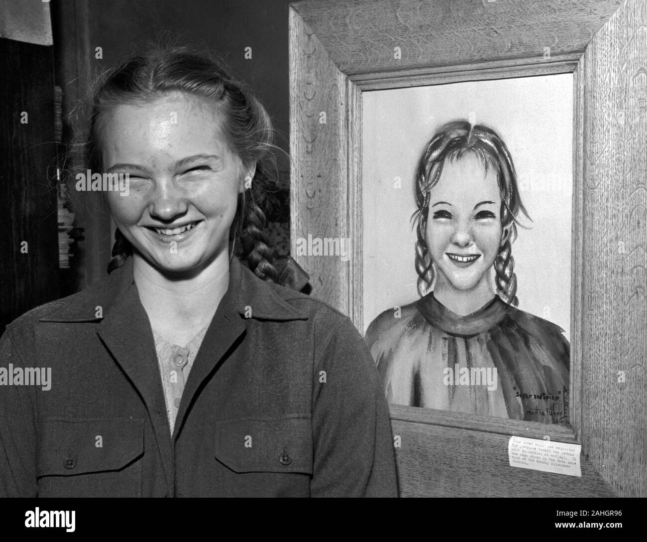 A girl in 1946 posing with a portrait of her, by Martha Fisher. The portrait was entered into an art contest in Madison Wisconsin in March 1946. Stock Photo