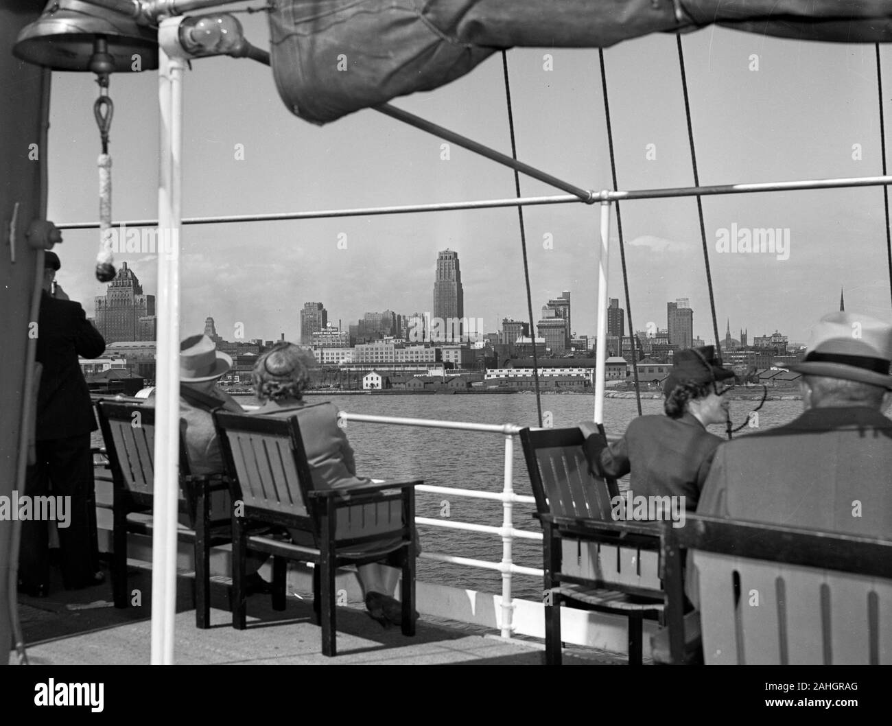 Passengers view the Toronto skyline from the deck of the passenger liner S.S. North America, 1942 Stock Photo
