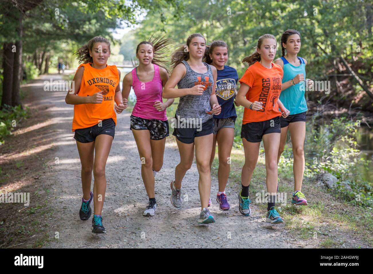 A group of girls running for exercise Stock Photo - Alamy