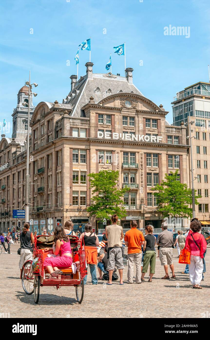 De Bijendorf Department Store at the Damrak shopping street in the inner city of Amsterdam, Holland. Stock Photo