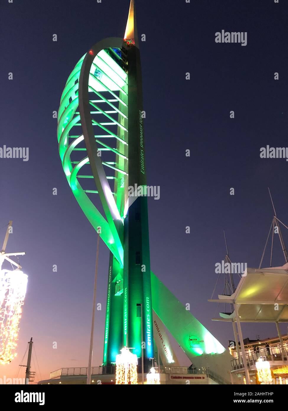 Sunset over the Solent at Portsmouth, Spinnaker Tower light up in Green. Stock Photo