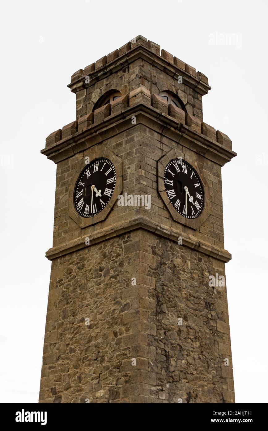 Galle, Sri Lanka. 2019 Nov 19 :  City clock tower in Galle Fort in Bay of Galle on southwest coast of Sri Lanka. Stock Photo