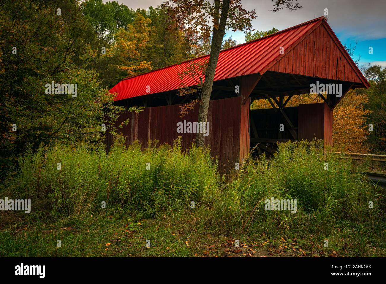 A beautiful little covered bridge spans Sterling Brook, near Morristown, VT. Stock Photo