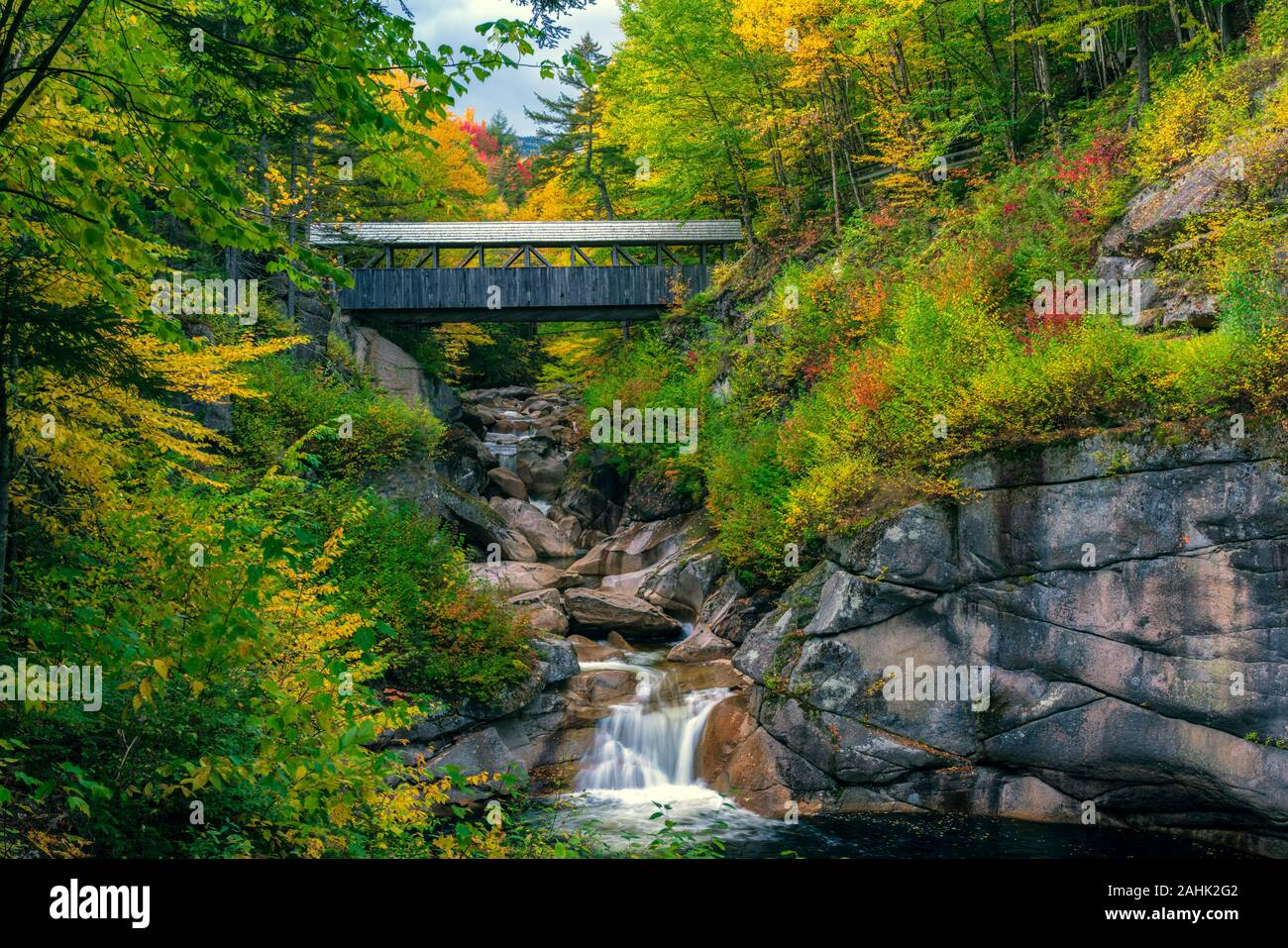 The Sentinel Pine covered bridge spans the Pemigewasset River in the Flume gorge, near Lincoln, NH. Stock Photo