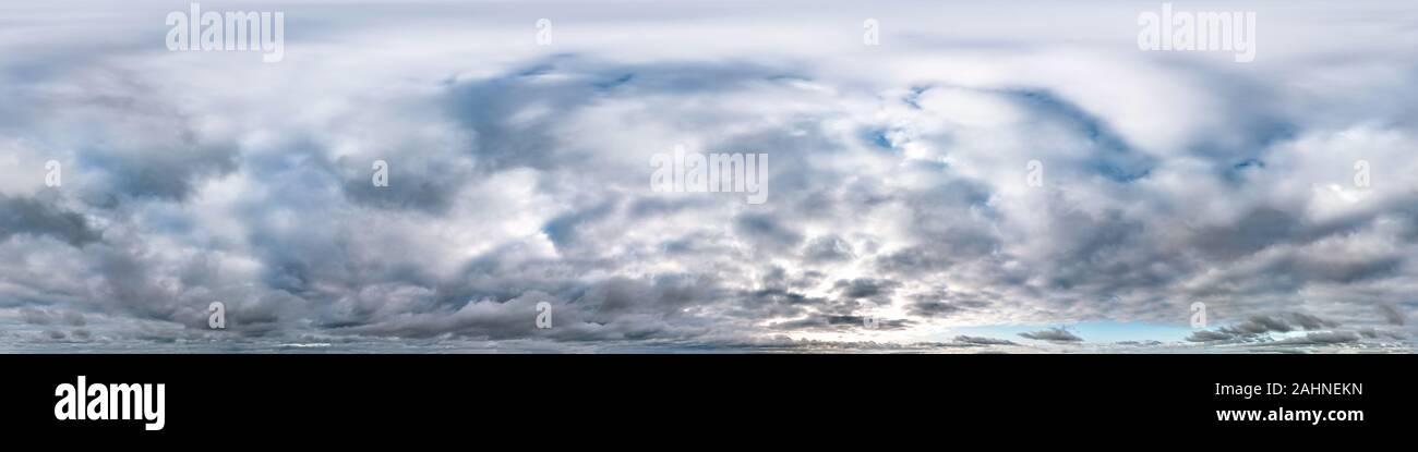blue sky with beautiful evening cumulus clouds. Seamless hdri panorama 360 degrees angle view with zenith for use in graphics or game development as s Stock Photo