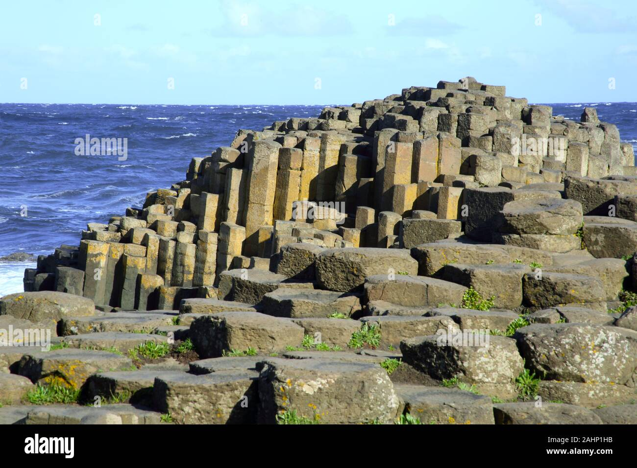 Dramatic coastline of stepping stones and basalt columns of the Giant's Causeway, County Antrim, Northern Ireland, UK, Europe. Stock Photo