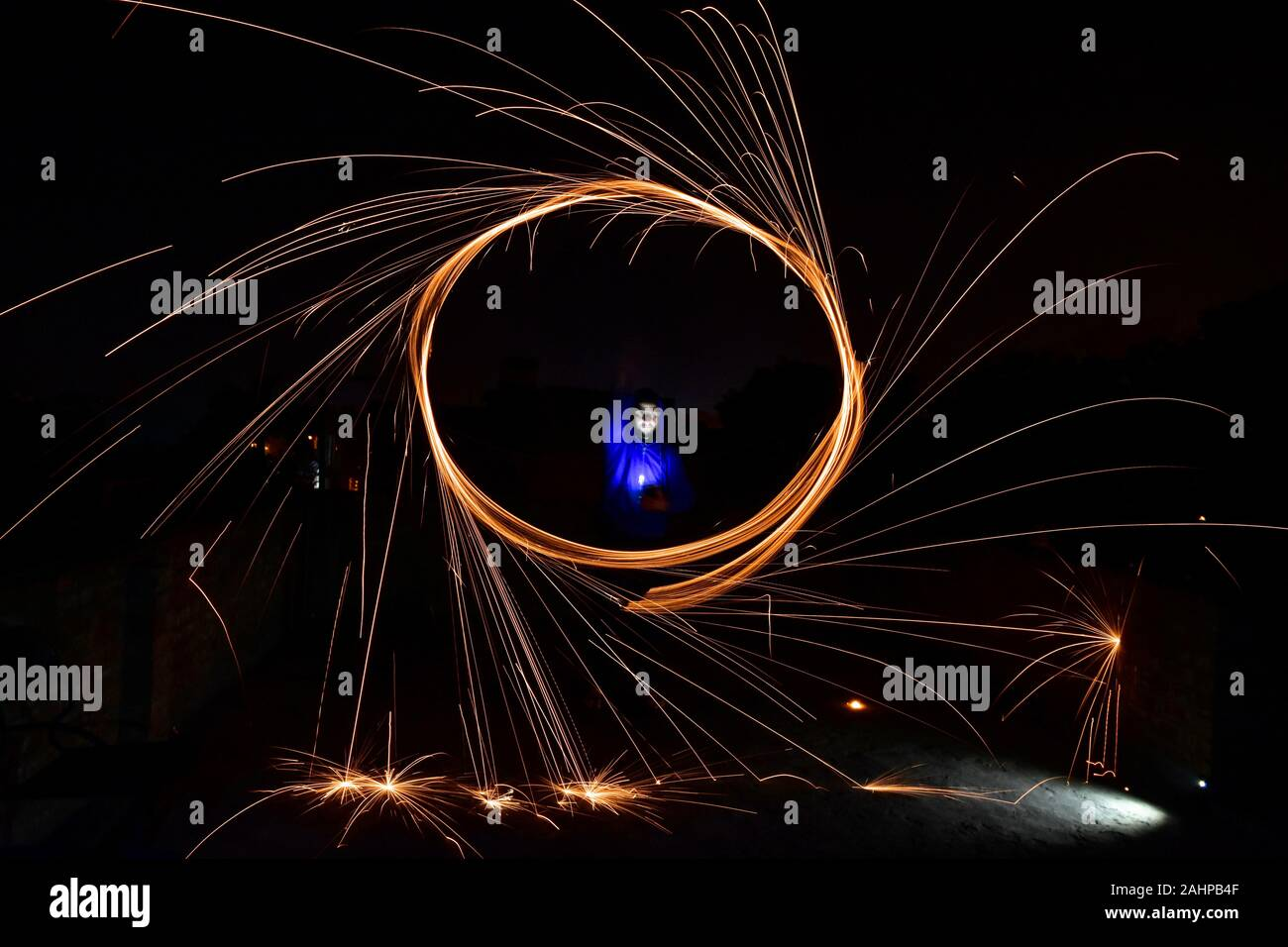 January 1, 2020, Rajpura, India: A boy spins a burning steel wool with a sling performing light painting during the New Year celebrations in Rajpura town. (Credit Image: © Saqib Majeed/SOPA Images via ZUMA Wire) Stock Photo