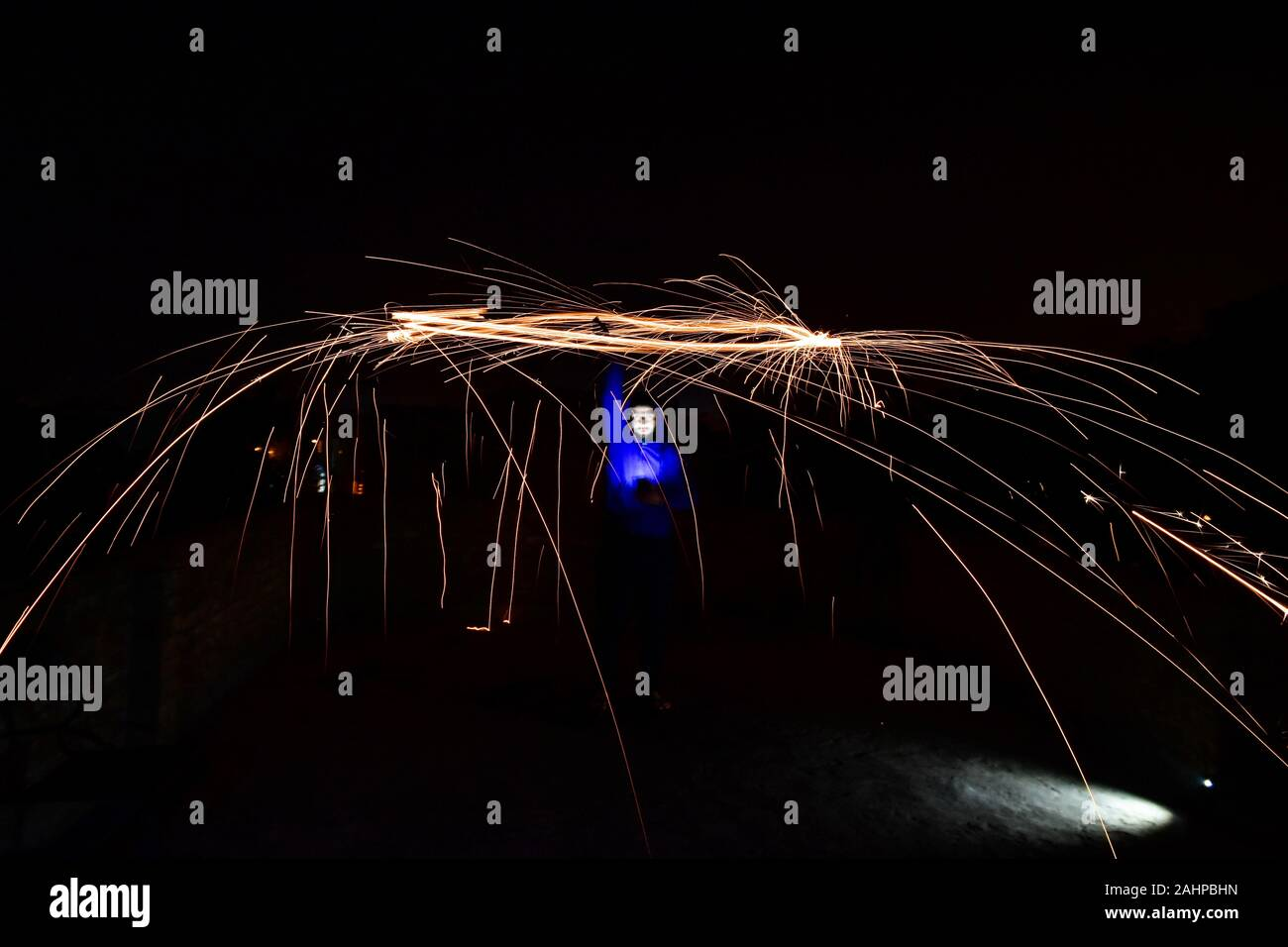 Rajpura, India. 1st Jan, 2020. A boy spins a burning steel wool with a sling performing light painting during the New Year celebrations in Rajpura town. Credit: Saqib Majeed/SOPA Images/ZUMA Wire/Alamy Live News Stock Photo