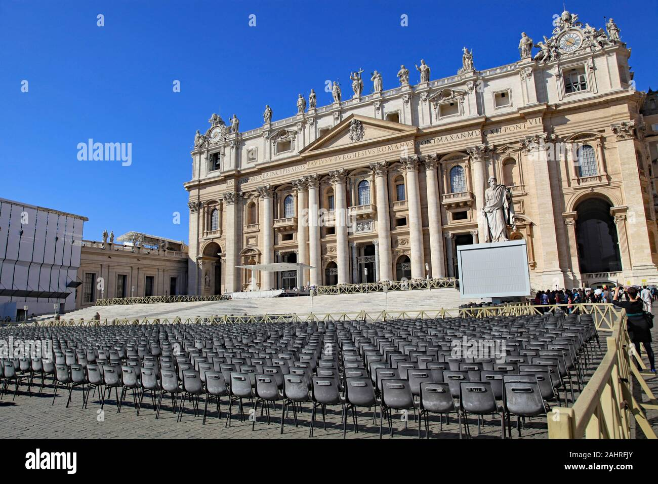 Empty chairs set up for a papal audience in front of St. Peter's Basilica, Vatican City, Rome Stock Photo