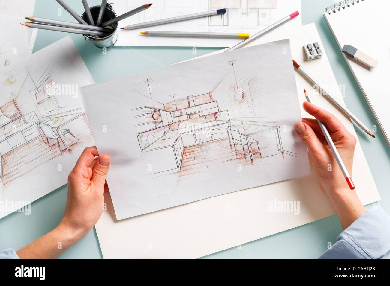 Interior Designer Holding Pencil Sketch Of A Kitchen In A Process Of Drawing Interior Design Projects Concept Stock Photo Alamy