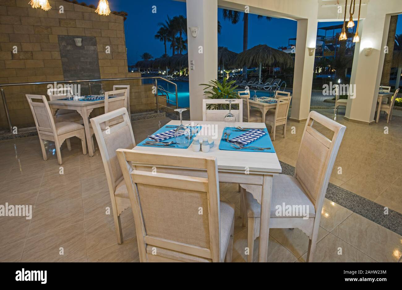 Interior Design Of A Luxury Hotel Restaurant Dining Area With Setting By Swimming Pool At Night Stock Photo Alamy
