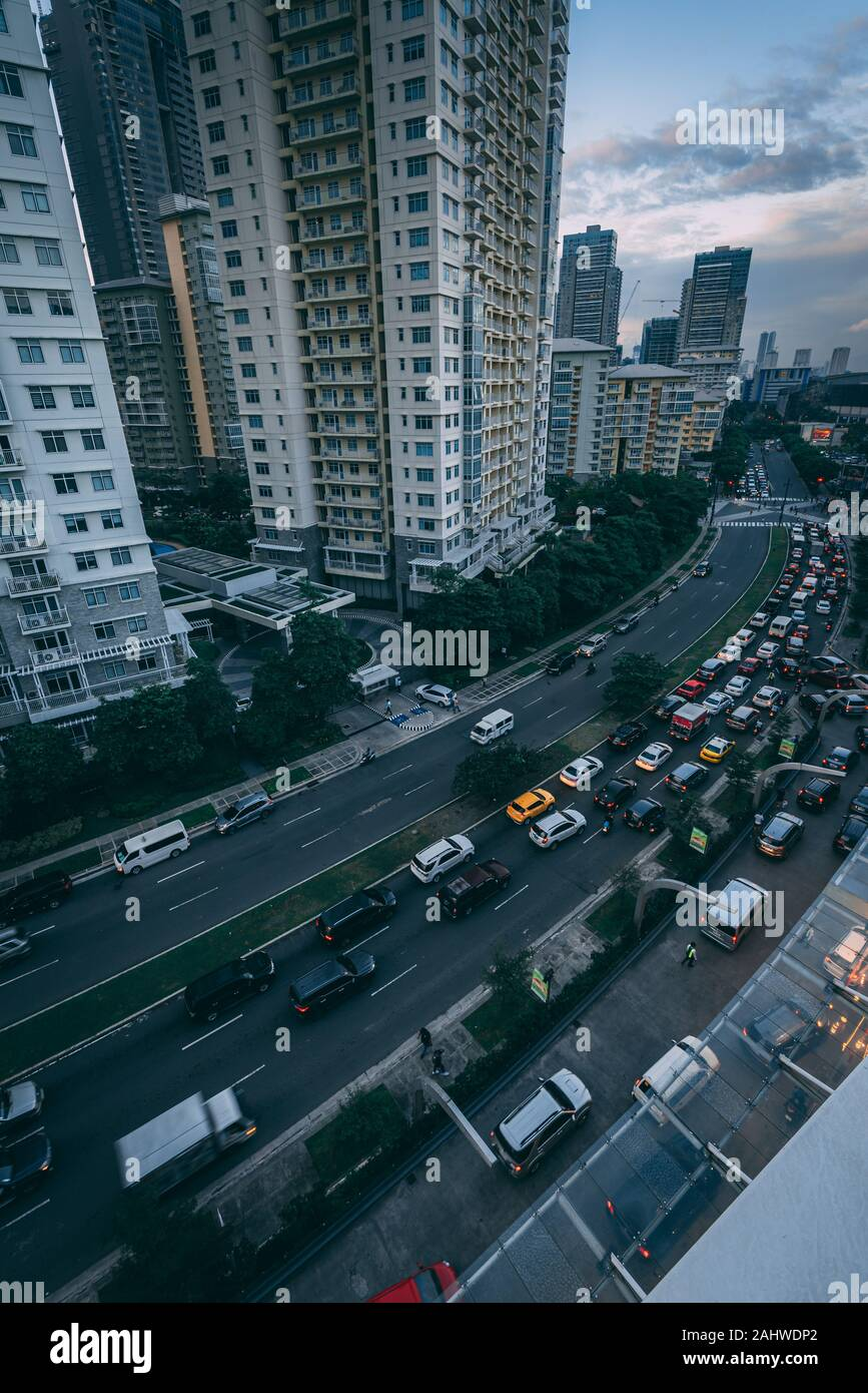 View of traffic on McKinley Parkway from SM Aura Premier, in Bonafacio Global City, Manila, Philippines Stock Photo